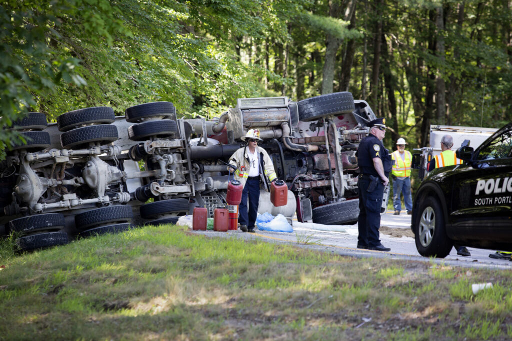 A cement truck rolled over on the South Portland connector to Interstate 295 on Wednesday morning, injuring the driver and spilling diesel fuel.