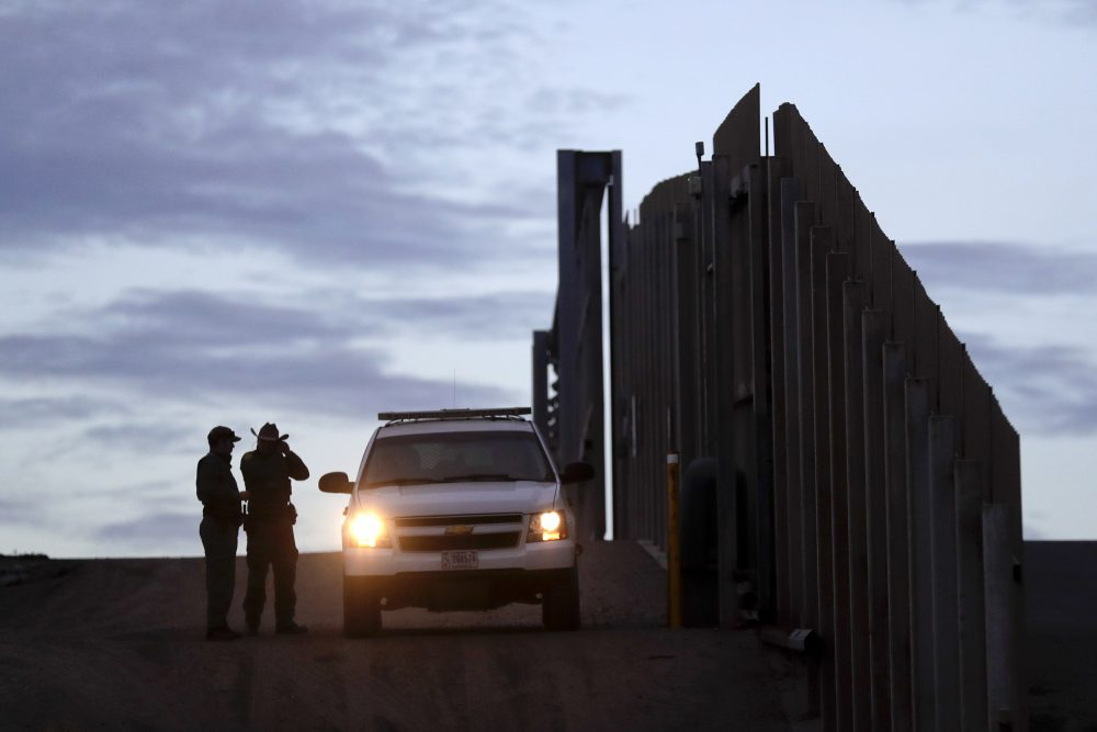 United States Border Patrol agents stand by a vehicle near one of the border walls separating Tijuana, Mexico and San Diego on Nov. 21, 2018.
