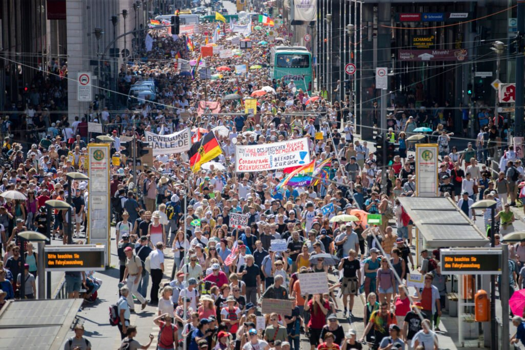 Thousands march along the Friedrichstrasse  during a demonstration against virus measures in Berlin, Germany, on Saturday.