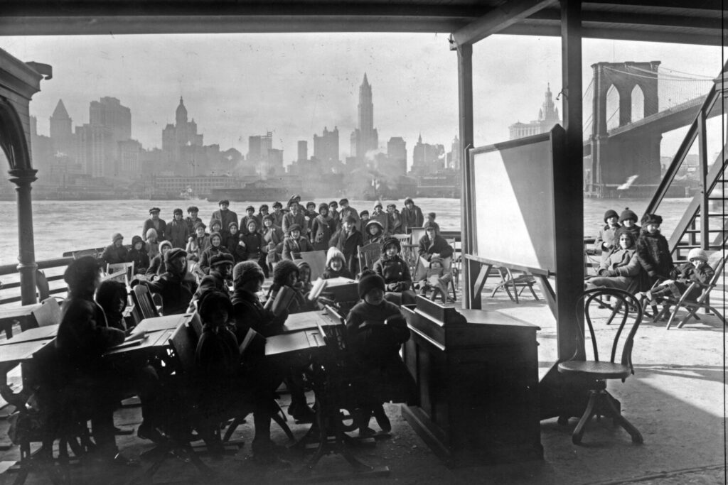 This 1911 photo from the Library of Congress shows schoolchildren on the ferry boat Rutherford, across the river from Manhattan, and near the Brooklyn Bridge, at right, in New York. Outdoor education was an early-20th century response to outbreaks of infectious diseases such as tuberculosis.