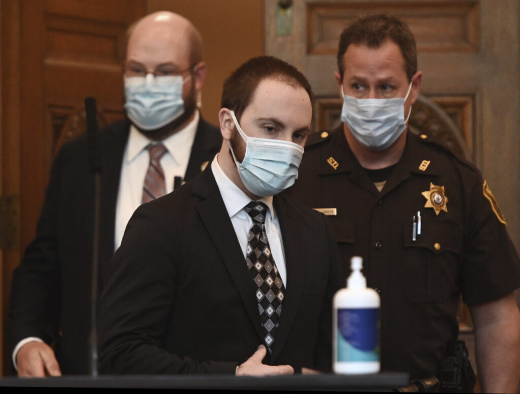 Mark Cardilli Jr. enters the Cumberland County Courthouse for his sentencing Monday, Aug. 31, 2020, in Portland, Maine. Cardilli Jr. admitted shooting 22-year-old Isahak Muse during a family fight. (Shawn Patrick Ouellette/Portland Press Herald via AP, Pool)