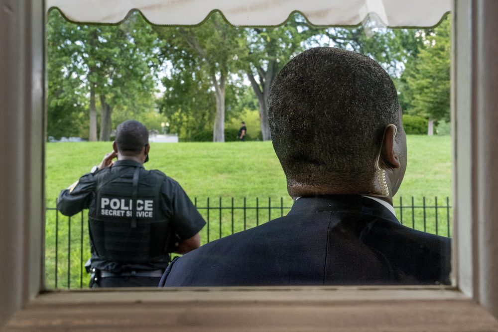 Members of the U.S. Secret Service stand guard outside the James Brady Press Briefing Room as President Trump holds a news conference at the White House on Monday in Washington. Trump briefly left because of a security incident outside the fence of the White House.
