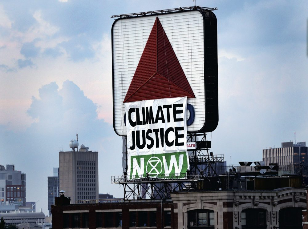 Members of an environmental group hung this banner on the iconic Citgo sign near Boston's Fenway Park on Monday. (Jim Davis/The Boston Globe via AP)