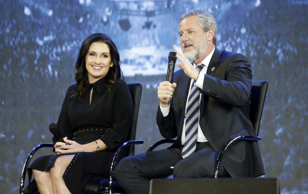 The Rev. Jerry Falwell Jr., right, and his wife, Becki during after a town hall at a convocation at Liberty University in Lynchburg, Va. on Nov. 28, 2018.