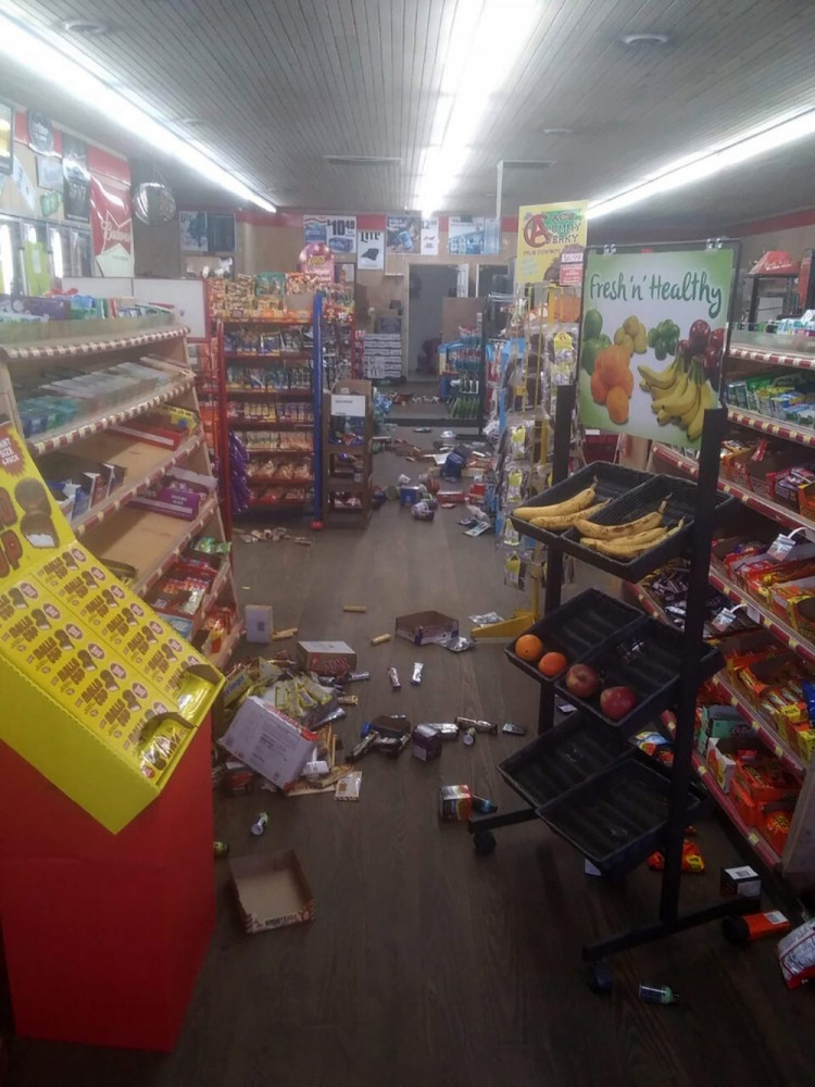 Various items litter the floor of the 4 Brothers Store in Sparta, N.C. after an earthquake shook much of North Carolina early Sunday.