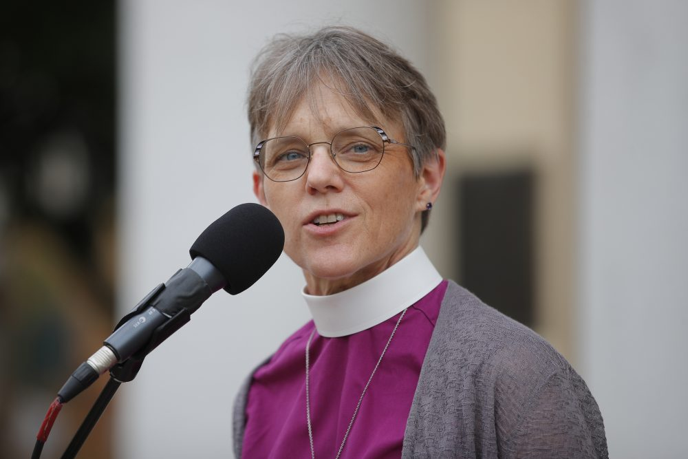 Bishop Mariann Edgar Budde of the Esiscopal Diocese of Washington speaks during a service outside St. John's Episcopal Church in Washington.
