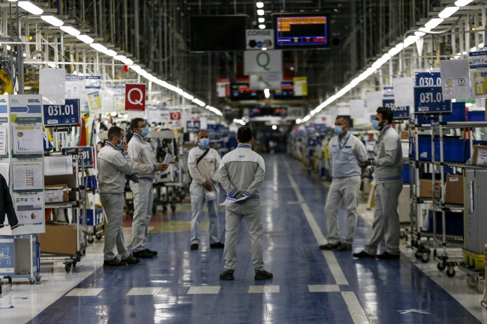 Managers talks to workers at the Fiat Chrysler Automobiles plants of Atessa, in Central Italy, on April 27. FCA is accused of bribing union and GM officials in a court motion filed Monday by GM.  (Cecilia Fabiano/LaPresse via AP, File)