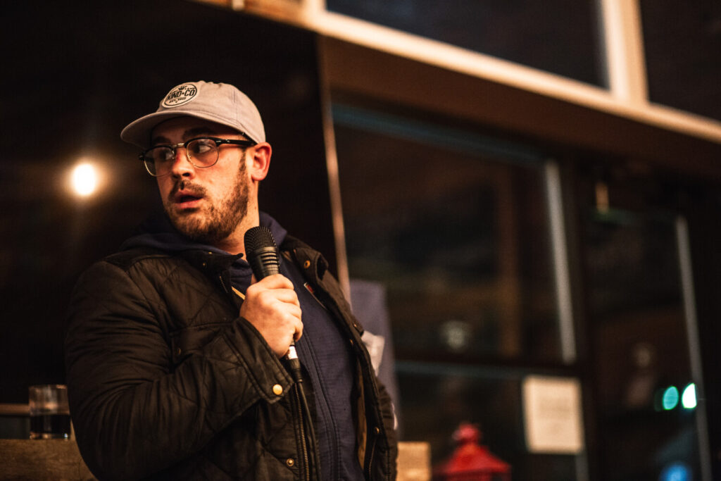 Comedian James Theberge hosts a weekly Thursday comedy show outside at Stroudwater Distillery on Thompson's Point in Portland.