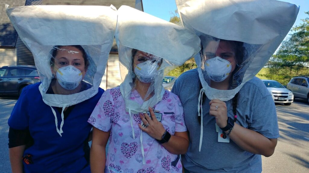 From left, Kaila O'Donnell, RN; Hannah Smith, C.N.A. and Sydney Perry, C.N.A., all work on the Memory Care for A Company of Maine Veterans' Homes - Augusta, recently were fit tested by members of the Maine National Guard task force med team.