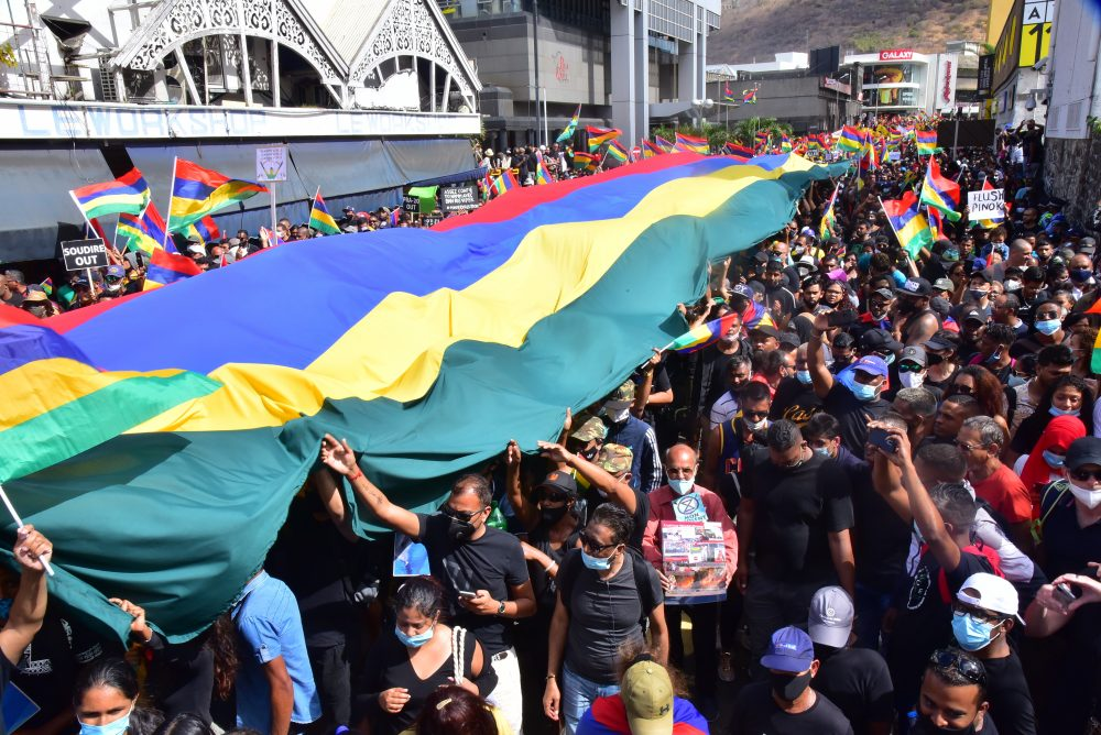 Tens of thousands of people protest in Port Louis, Mauritius, on Saturday over the government's slow response to an oil spill  and the discovery of dozens of dead dolphins.