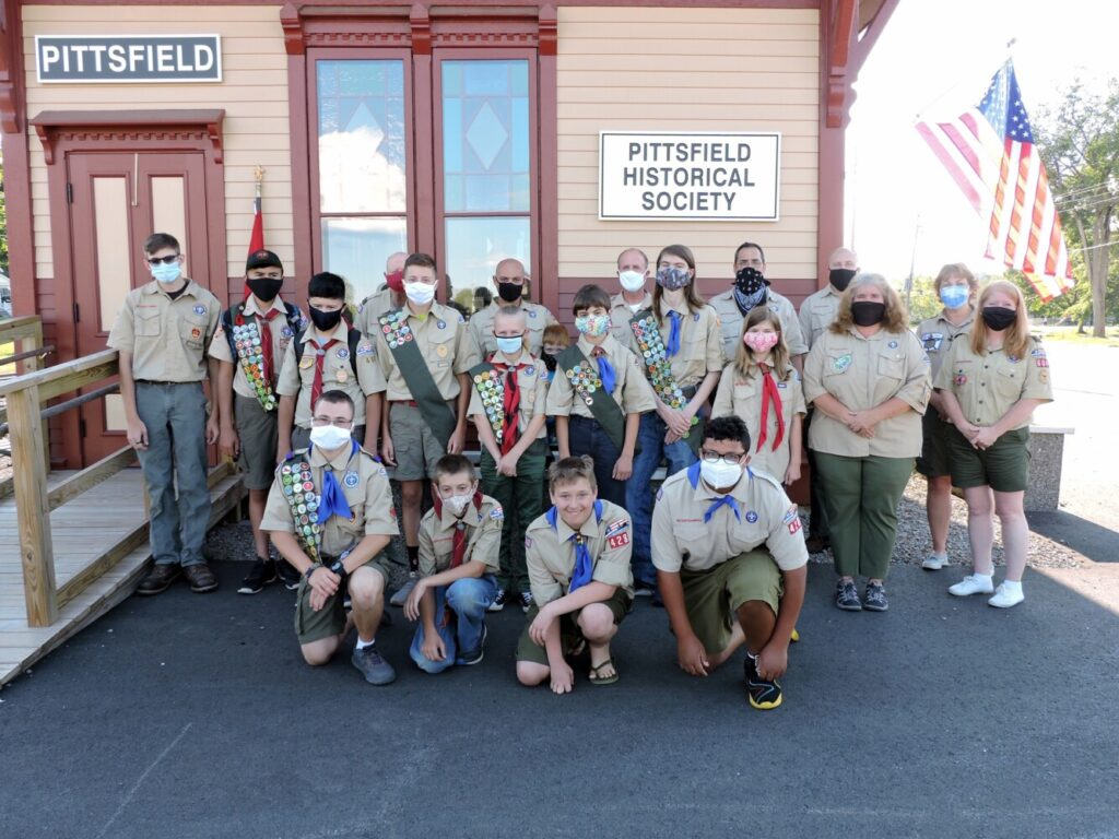 Pittsfield Boy Scout Troop 428 observes 105th anniversary of the Troop's founding in 1914. Front from left are Michael Connolly, Tyler Dearborn, Carl Tilton and Omar Jawo. Second row from left are Jeremiah Wiswall, Connor Files, Owen Riddle, Glenn Modrusan and Katrina Modrusan,  all of Troop 41G. Third row from left are Ethan Emery, senior patrol leader; Noah Wiswall, Lukas Modrusan, assistant senior patrol leader; Shelley Connolly, Scoutmaster; and Tammy Smith, Kennebec Valley District Commissioner. Fourth row from left are  David Riddle, assistant Scoutmaster; David Whitman, assistant Scoutmaster; Ryan Stanley, Darren Files, advancement chairman;Donald Gage, assistant Scoutmaster; Matthew Klutzaritz, Pine Tree Council Scout Executive; and Kelly Pillsbury, Kennebec Valley District Chairwoman.