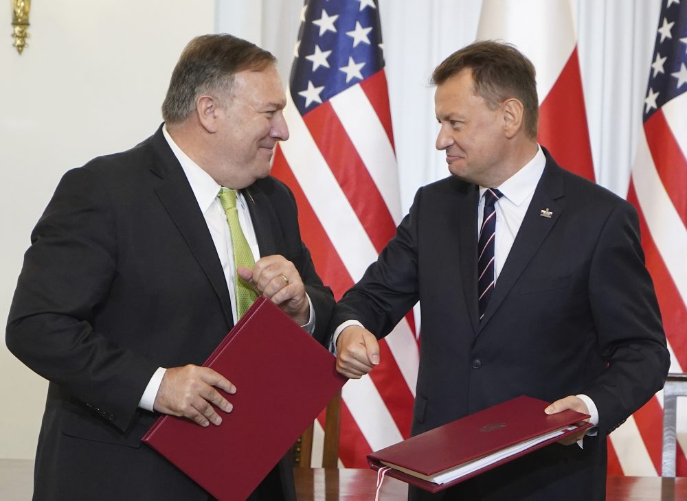 US Secretary of State Mike Pompeo, left, and Poland's Minister of Defence Mariusz Blaszczak greet each other after signing the U.S.-Poland Enhanced Defence Cooperation Agreement in the Presidential Palace in Warsaw on Saturday.