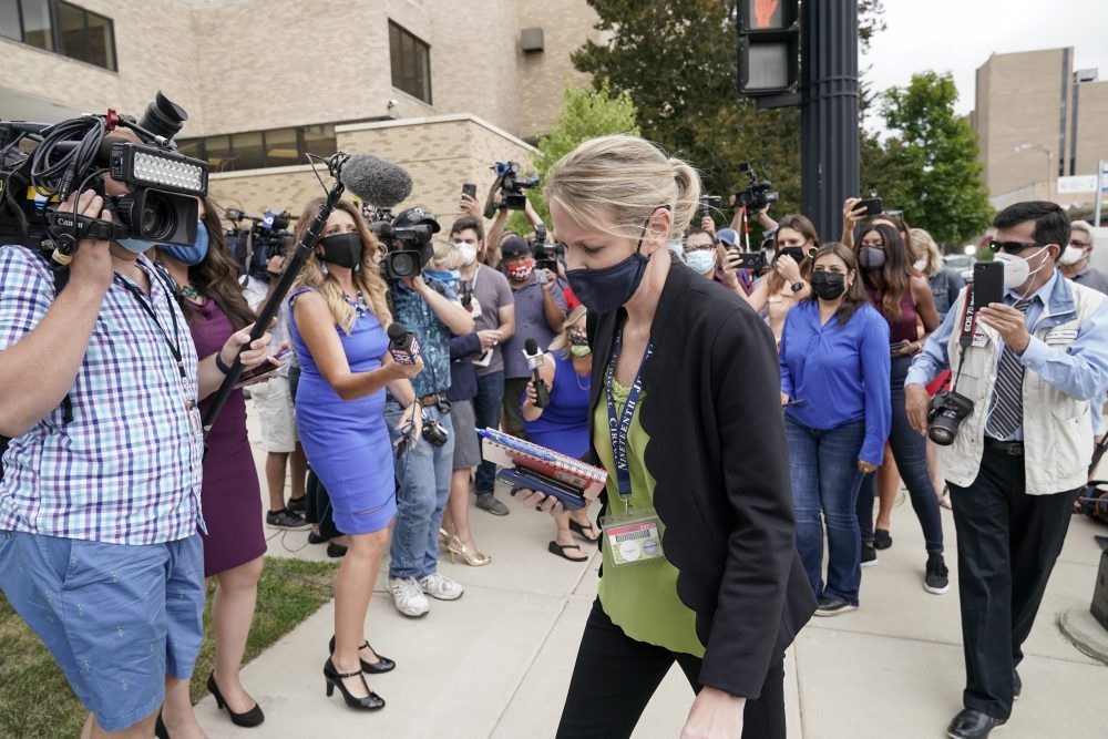 Kasey Morgan, a public information officer for the Lake County Court, walks away from reporters outside the Lake County courthouse following the extradition hearing for Kyle Rittenhouse on Friday in Waukegan, Ill.