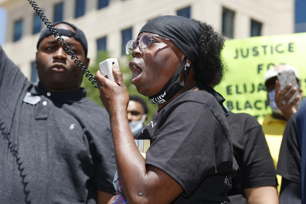 Sheneen McClain, mother to Elijah McClain, speaks during a rally and march on June 27 over the death of her son. The McClain's filed a lawsuit again Aurora, Colo., police.