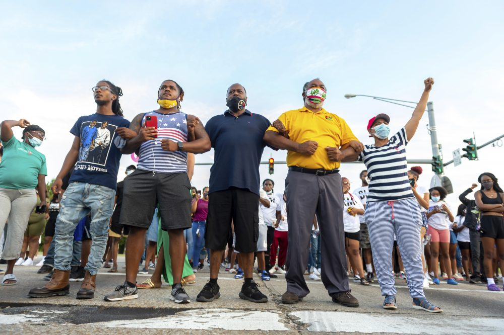 Protesters take to the street and block traffic at the intersection of Willow Street and Evangeline Thruway after a vigil held Saturday, in Lafayette, La., for 31-year-old Trayford Pellerin, who was shot and killed by Lafayette police officers while armed with a knife the night before.