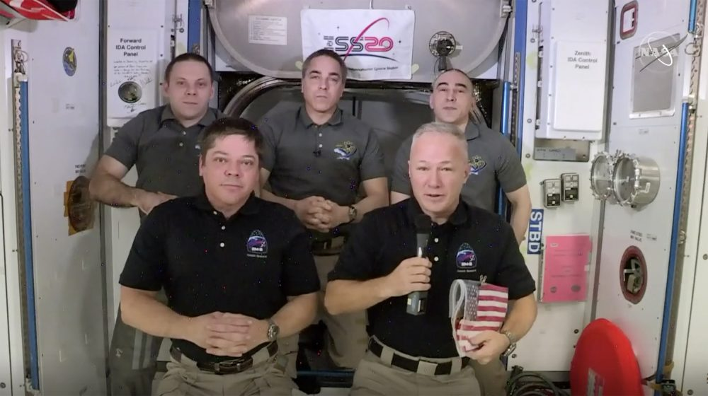Astronauts Bob Behnken, from left front, and Doug Hurley take part in an interview on the International Space Station on Saturday.