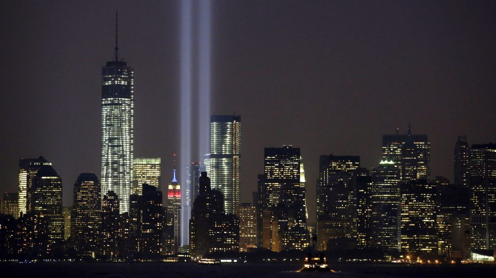 The twin beams of the annual Tribute in Light commemorating the Sept. 11, 2001, terrorist attacks shine amid the city's skyline, Sept. 11, 2013, in New York.