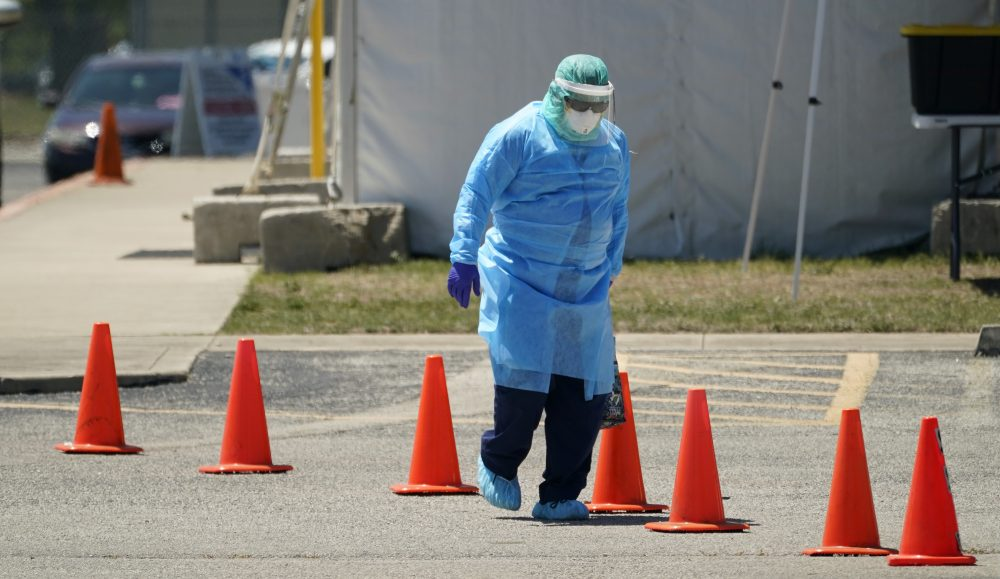 Medical personnel prepare a drive-thru COVID-19 testing site, Friday in San Antonio. Coronavirus testing in Texas has dropped significantly, mirroring nationwide trends, just as schools reopen and football teams charge ahead with plans to play.