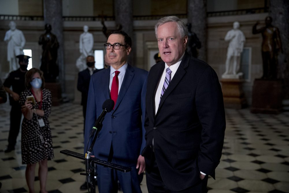 White House Chief of Staff Mark Meadows, right, accompanied by Treasury Secretary Steven Mnuchin, left, speaks to reporters on Aug. 7. Meadows rejected the legislation the House passed late Saturday to provide $25 billion and block operational changes by Postmaster General Louis DeJoy.