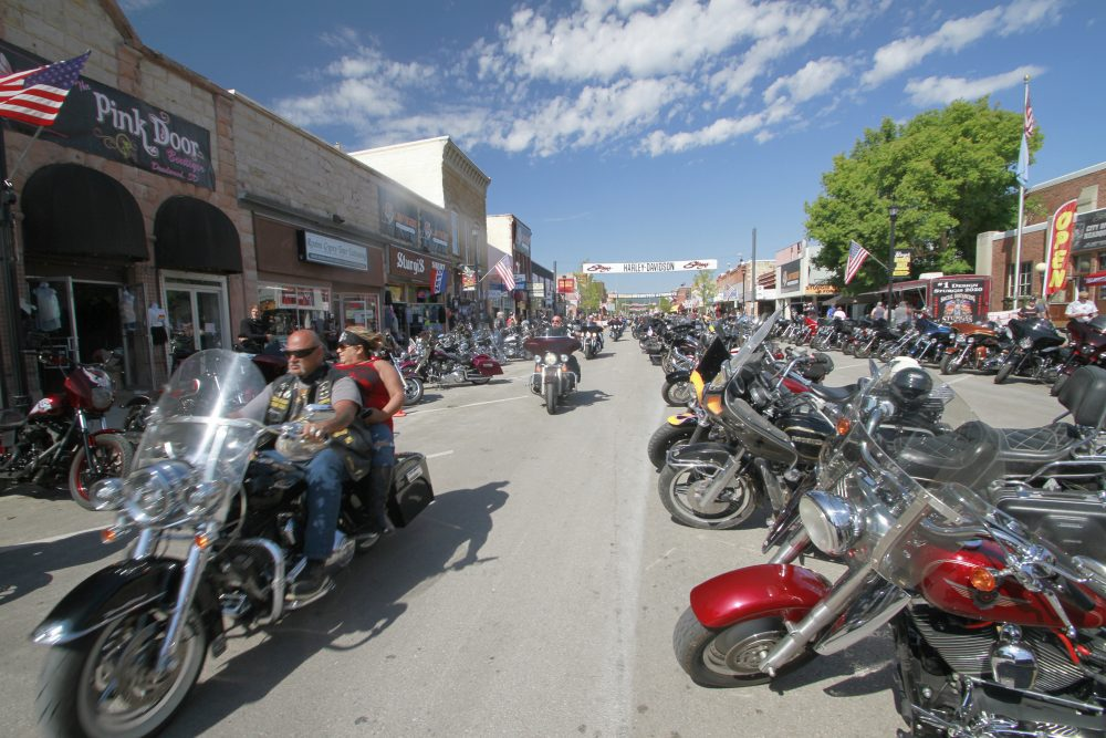 Thousands of bikers rode through the streets for the opening day of the 80th annual Sturgis Motorcycle rally Friday in Sturgis, S.D.