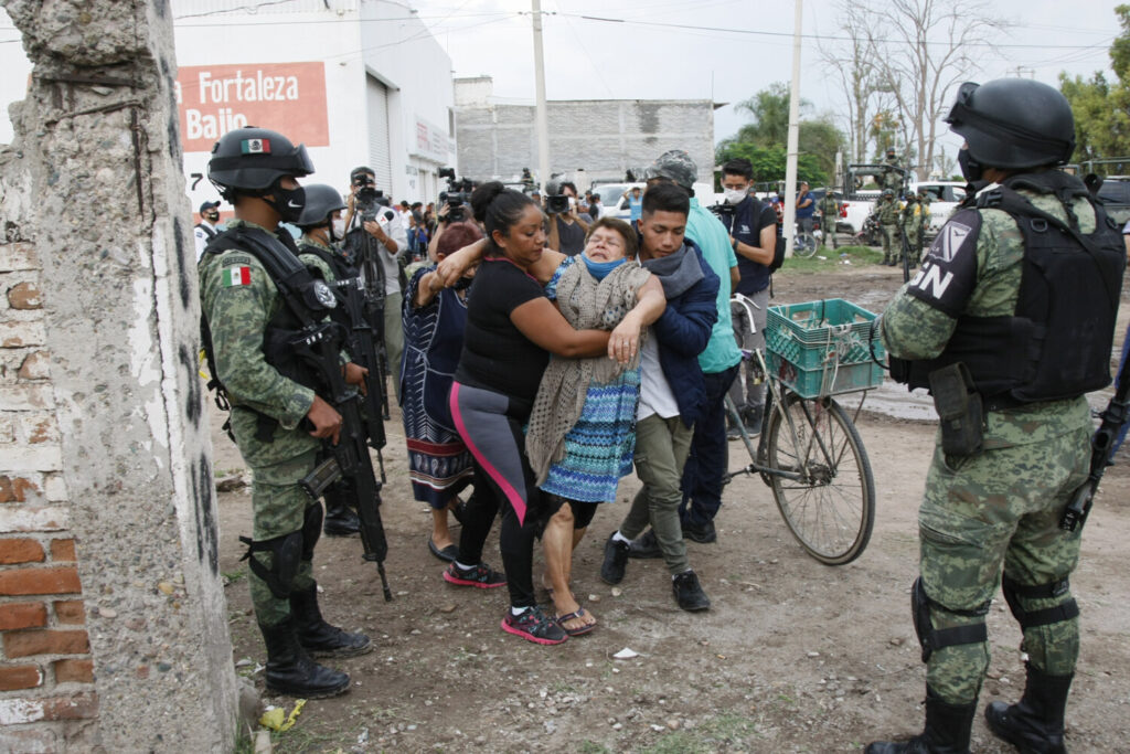 A woman cries outside the rehabilitation center attacked by armed assailants in Irapuato, Guanajuato, Mexico on July 1. Twenty-four people were killed and seven were injured, local media reported. The state has become one of the most dangerous regions in the country.