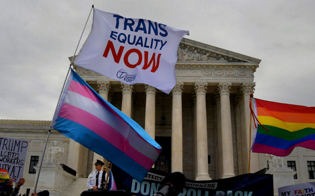 People gather outside  the Supreme Court on Oct. 8, 2019, when the justices heard arguments in the case surrounding transgender protections in the workplace. Monday's federal court ruling  delivers a blow to the Trump administration's ongoing efforts to roll back a series of protections for the LGBTQ community.