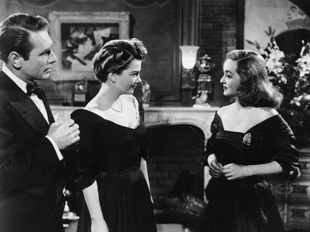 "Bette Davis, right, in a scene from the film ""All About Eve,"" with her co-stars Gary Merrrill, left, and Anne Baxter, 1950."