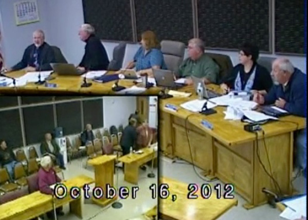 Waterboro selectmen and the audience react as the chamber is rocked by an earthquake on Oct. 16, 2012.