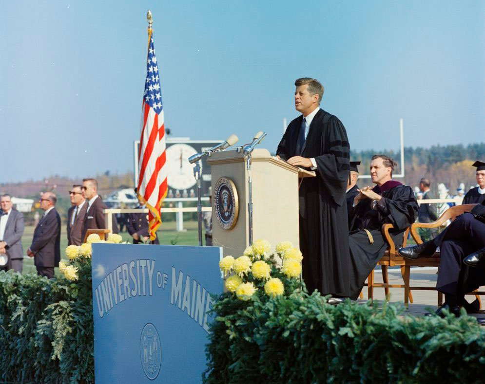President John F. Kennedy speaks at the University of Maine in Orono on October 19, 1963. Sen. Edmund Muskie sits behind and to the right of the president.