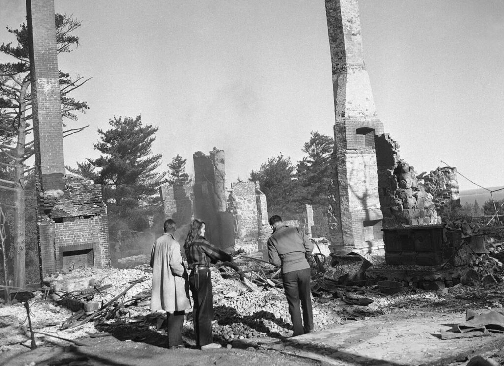 Stark chimneys and brick rubble mark the site of the once-luxurious estate of conductor Walter Damrosch, burned when a forest fire swept Bar Harbor in October of 1947.