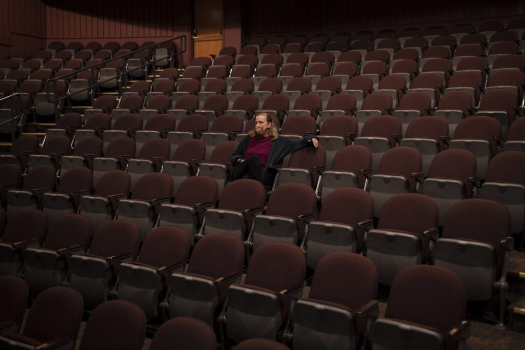 Anita Stewart, executive and artistic director of Portland Stage, poses for a portrait in the theater earlier in September. Portland Stage, and other Maine theaters, are slowly reopening this fall, with many pandemic precautions in place.