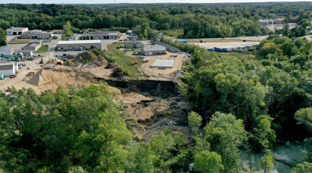 The landslide that blocked the Presumpscot River occurred behind 161 Warren Ave. in Westbrook on Wednesday morning.