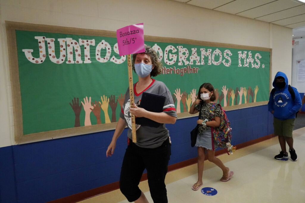 Edith Bonazza guides her 5th graders to their classroom at Oak Terrace Elementary School in Highwood, Ill., on Sept. 3. Leaders in Arizona, Kansas, New Hampshire, Pennsylvania and Texas have said they are bracing for worsening teacher shortages.