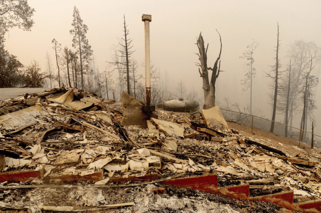 Charred remains is all that is left of a home destroyed by the Creek Fire on Tuesday, Sept. 8, in Fresno County, Calif.