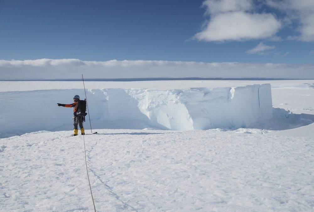 Field guide Andy Hood traverses the Brunt ice shelf in Antarctica last January. Now, as nearly 1,000 scientists and others who wintered over on the ice are seeing the sun for the first time in months, a global effort wants to make sure incoming colleagues don't bring the virus with them. (Robert Taylor/British Antarctic Survey via AP)