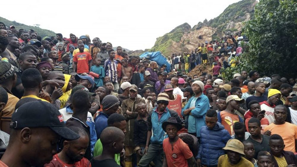 People gather at the scene of a gold mine collapse near the town of Kamituga, South Kivu province, in eastern Congo on Friday.