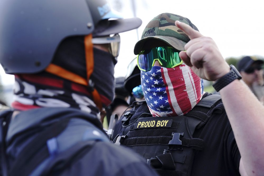 A right-wing demonstrator gestures toward a counterprotester as members of the Proud Boys and other right-wing demonstrators rally in Portland, Ore., this week. During Tuesday's debate, President Trump didn't condemn white supremacist groups and their role in violence in some American cities this summer.