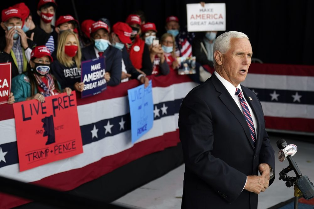 Vice President Mike Pence gives a television interview after a campaign rally on Tuesday at Lanconia Municipal Airport in Gilford, N.H.