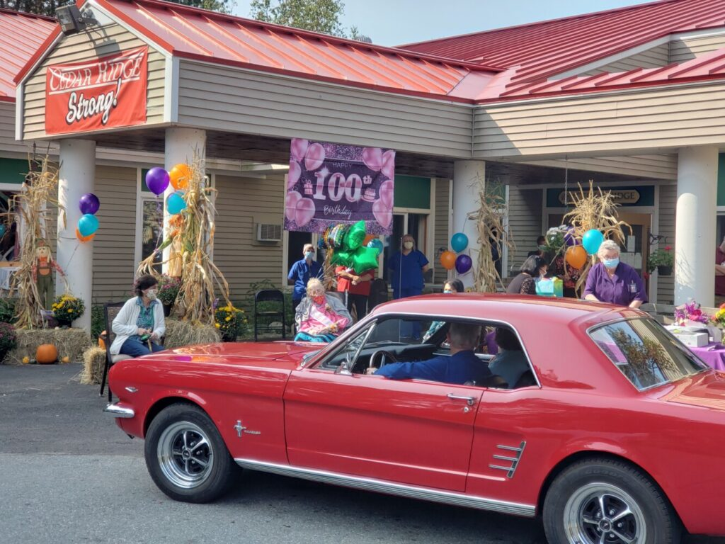 G. Arlene Elias, seated underneath the Happy 100th Birthday banner with balloons tied to her chair was given an outdoor celebration Sept. 16 with a parade of antique automobiles at Cedar Ridge Center in Skowhegan.