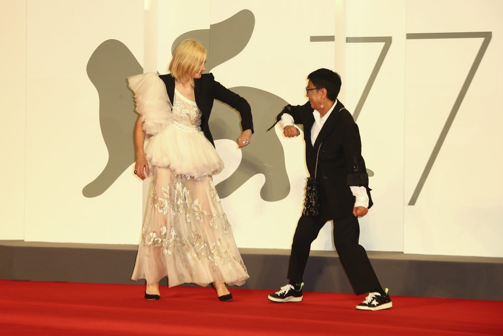 Director Ann Hui, right, and Jury President Cate Blanchett greet one another by touching elbows upon arrival at the red carpet for the Lifetime Achievement award for Ann Hui during the 77th edition of the Venice Film Festival in Venice, Italy, on Tuesday.