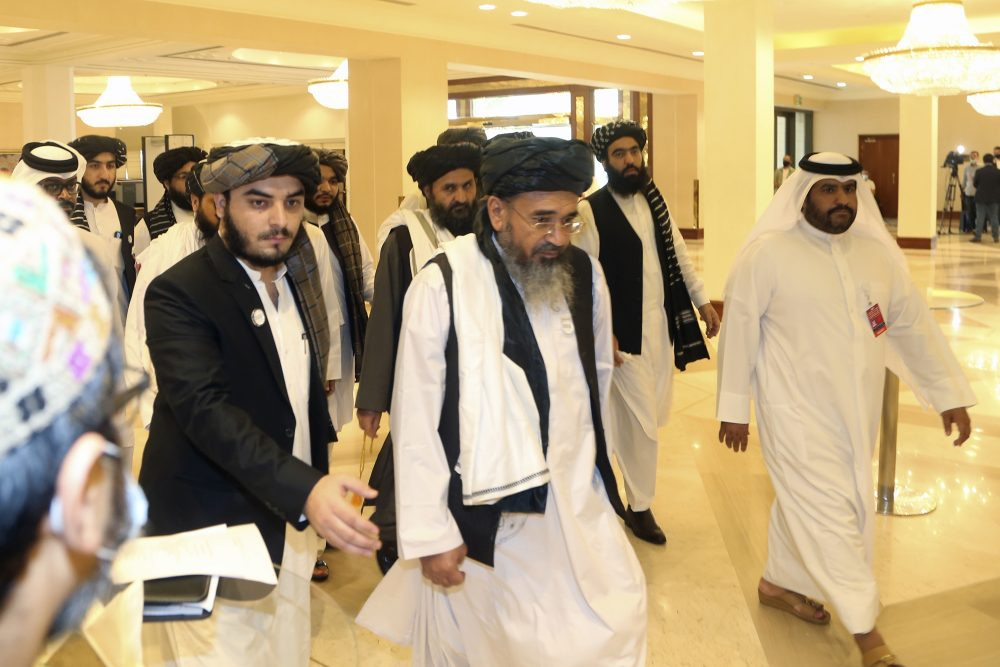 Taliban delegation arrive to attend the opening session of the peace talks Saturday between the Afghan government and the Taliban in Doha, Qatar.