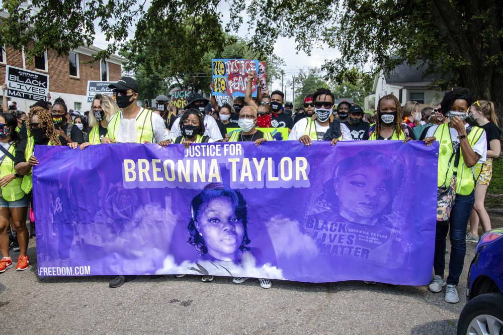 Protesters participate in the Good Trouble Tuesday march for Breonna Taylor on Aug. 25, in Louisville, Ky. A lawyer for Taylor's family said a plea deal was offered to an accused drug trafficker that would have forced him to implicate Taylor, who was killed by police in a raid on her home in March.