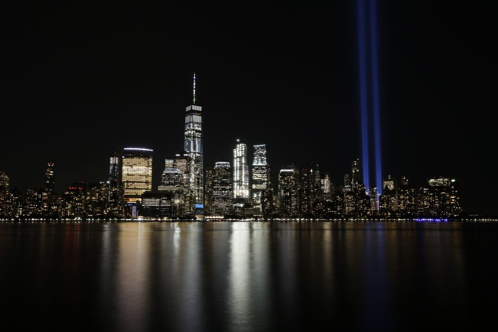 The Tribute in Light illuminates in the sky above the Lower Manhattan area of New York on Sept. 11, 2017, as seen from across the Hudson River in Jersey City, N.J.