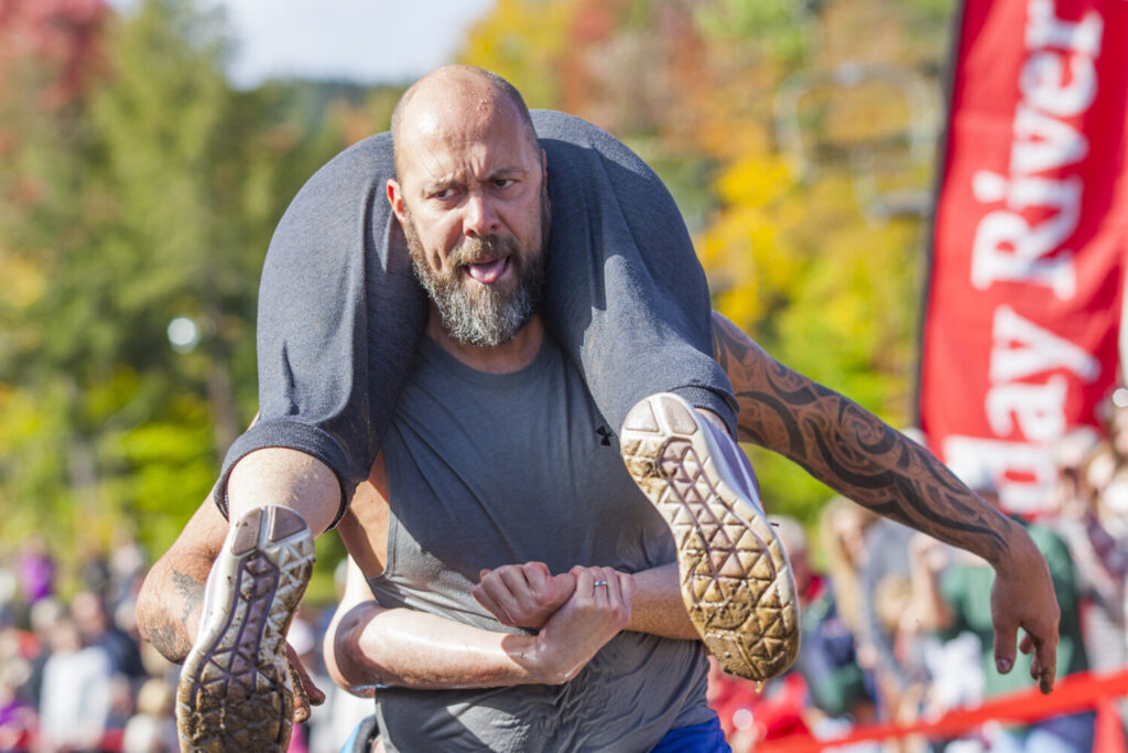 The North American Wife Carrying Championship will be held Oct. 9 at Sunday River, but with fans a little farther from the action.