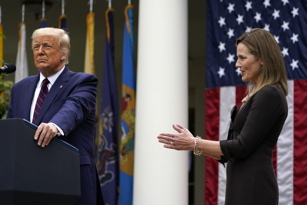 Judge Amy Coney Barrett applauds as President Trump announces Barrett as his nominee to the Supreme Court, in the Rose Garden at the White House on Saturday.