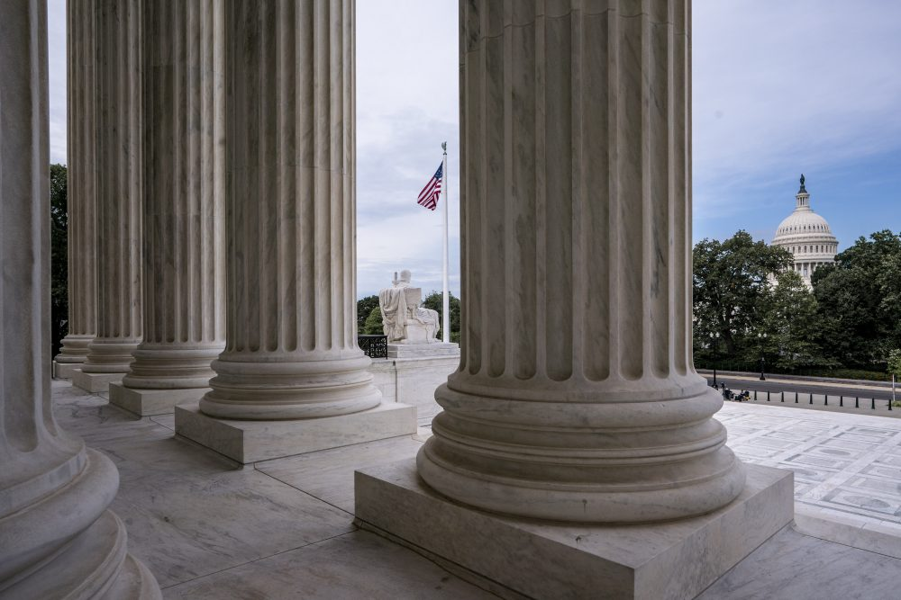 The columns of the Supreme Court are seen June 15 with the Capitol at right, in Washington.
