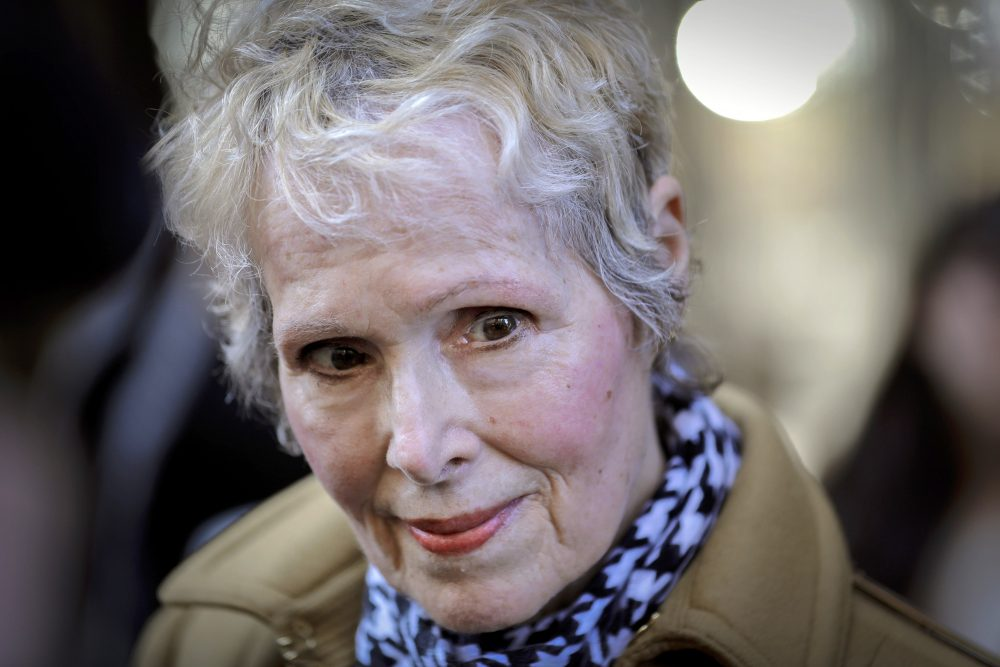 E. Jean Carroll talks to reporters outside a courthouse in New York on March 4. The U.S. Justice Department is seeking to take over President Trump's defense in a defamation lawsuit brought by Carroll, who accused the president of raping her in a New York luxury department store in the mid-1990s. Federal lawyers asked a court Tuesday to allow a legal move that could put the American people on the hook for any money she might be awarded.