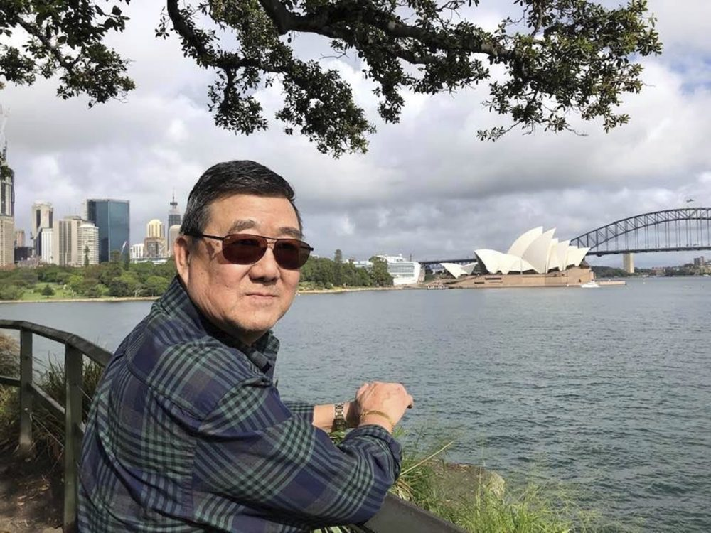 Ming Wang in Sydney, Australia, in March. The 71-year-old was sickened in March on a cruise from Australia with his wife, a break after decades of running the family's Chinese restaurant in Papillion, Neb.
