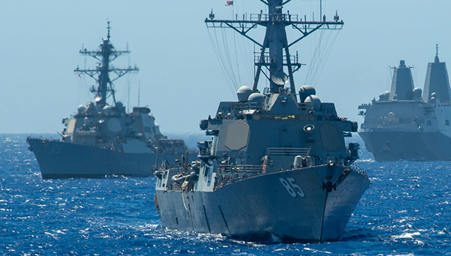 Two Arleigh Burke-class guided-missile destroyers, the USS McCampbell and the USS Milius (DDG 69) accompanied by the amphibious transport dock ship USS Green Bay in the Philippine Sea in 2019.