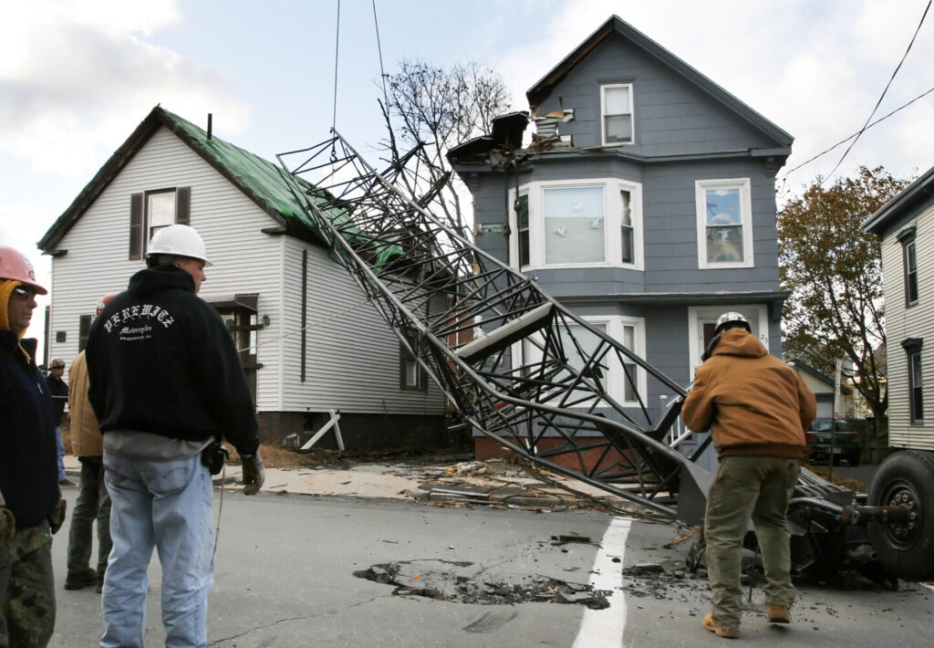 A crane from a construction area at Maine Medical Center toppled over, damaging several homes on Ellsworth Street in Portland on Oct. 29, 2006.